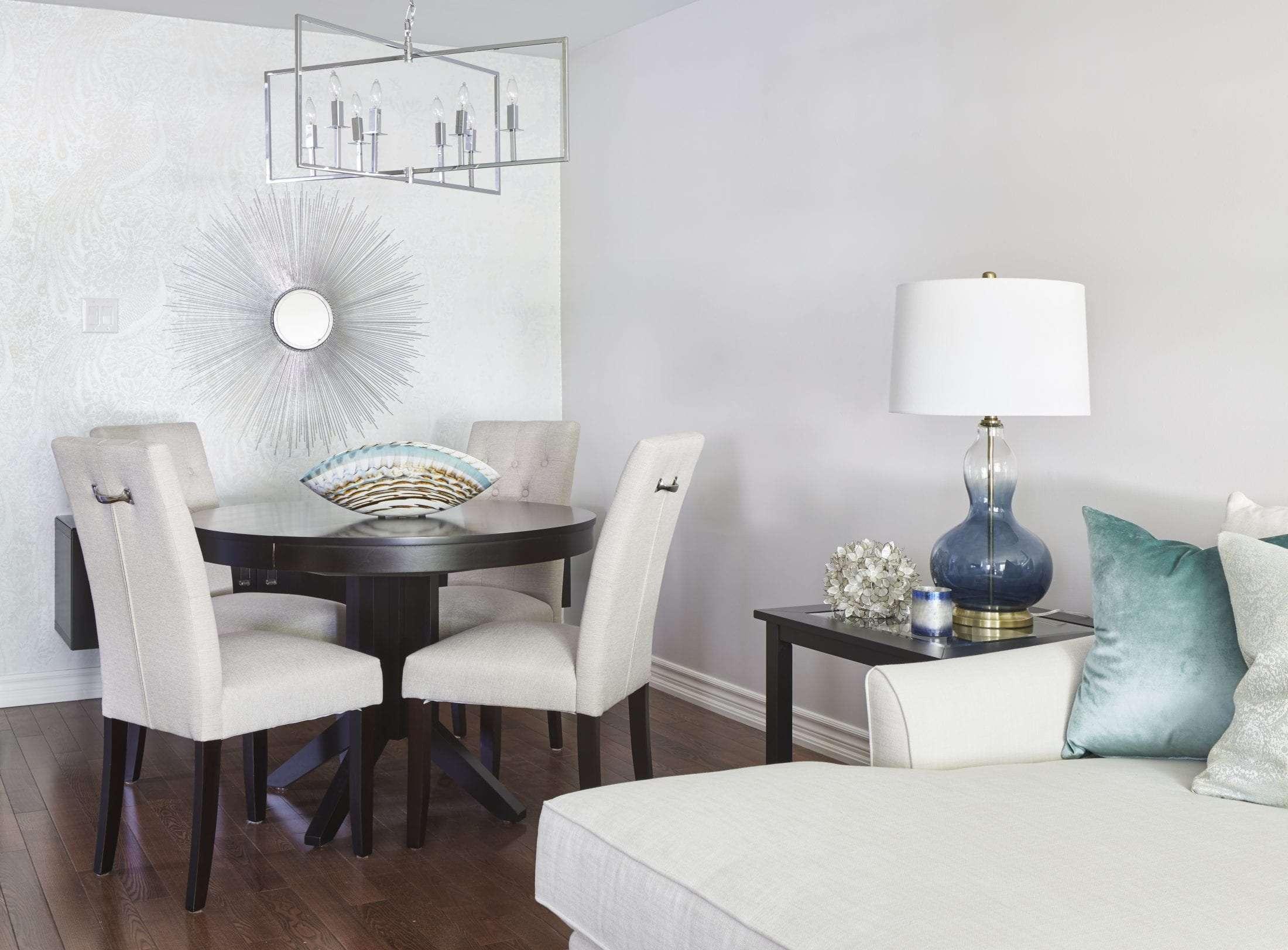 Elegant dining room wallpaper and starburst mirror