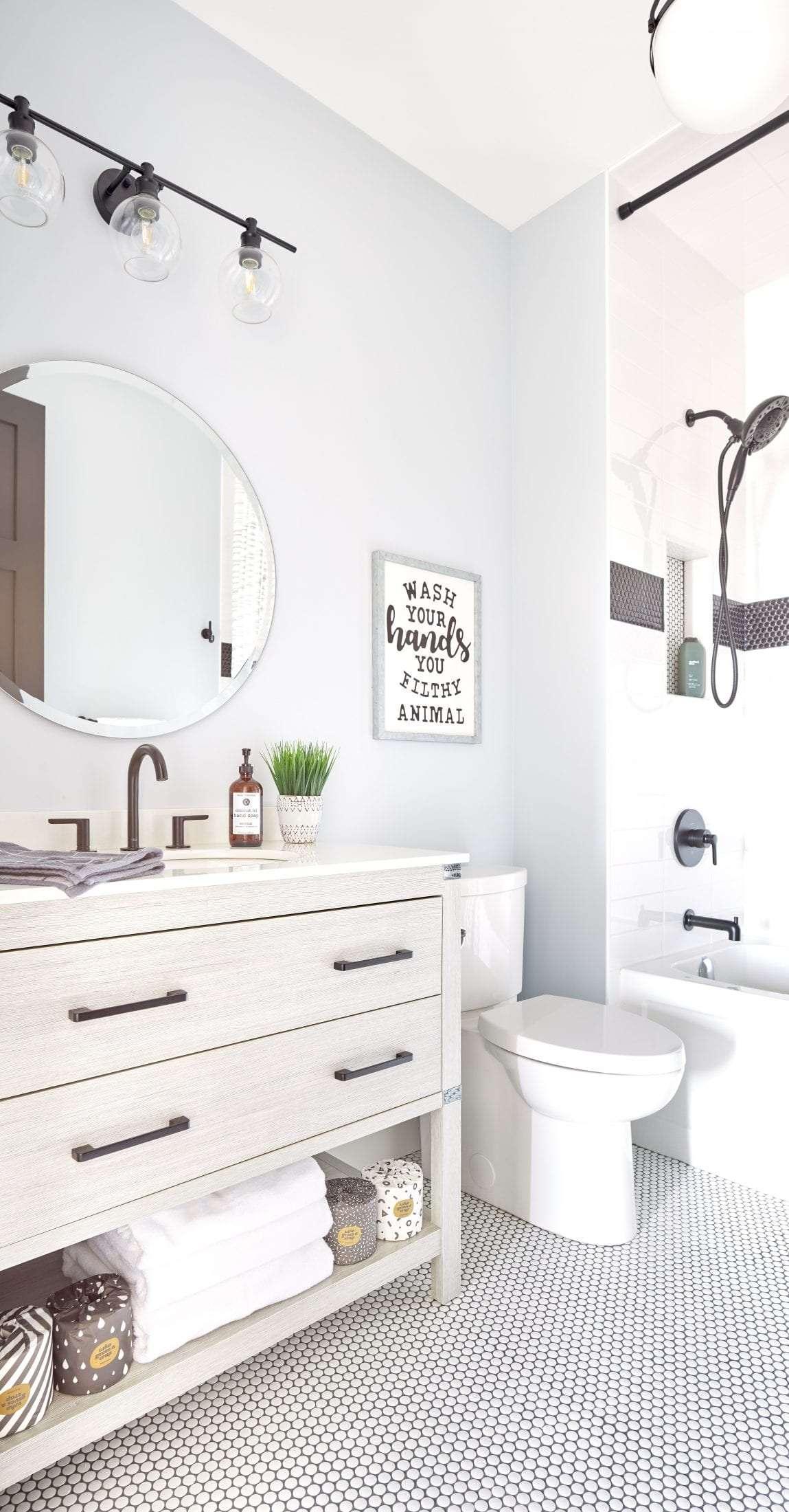 Guest bathroom design white penny tile black grout