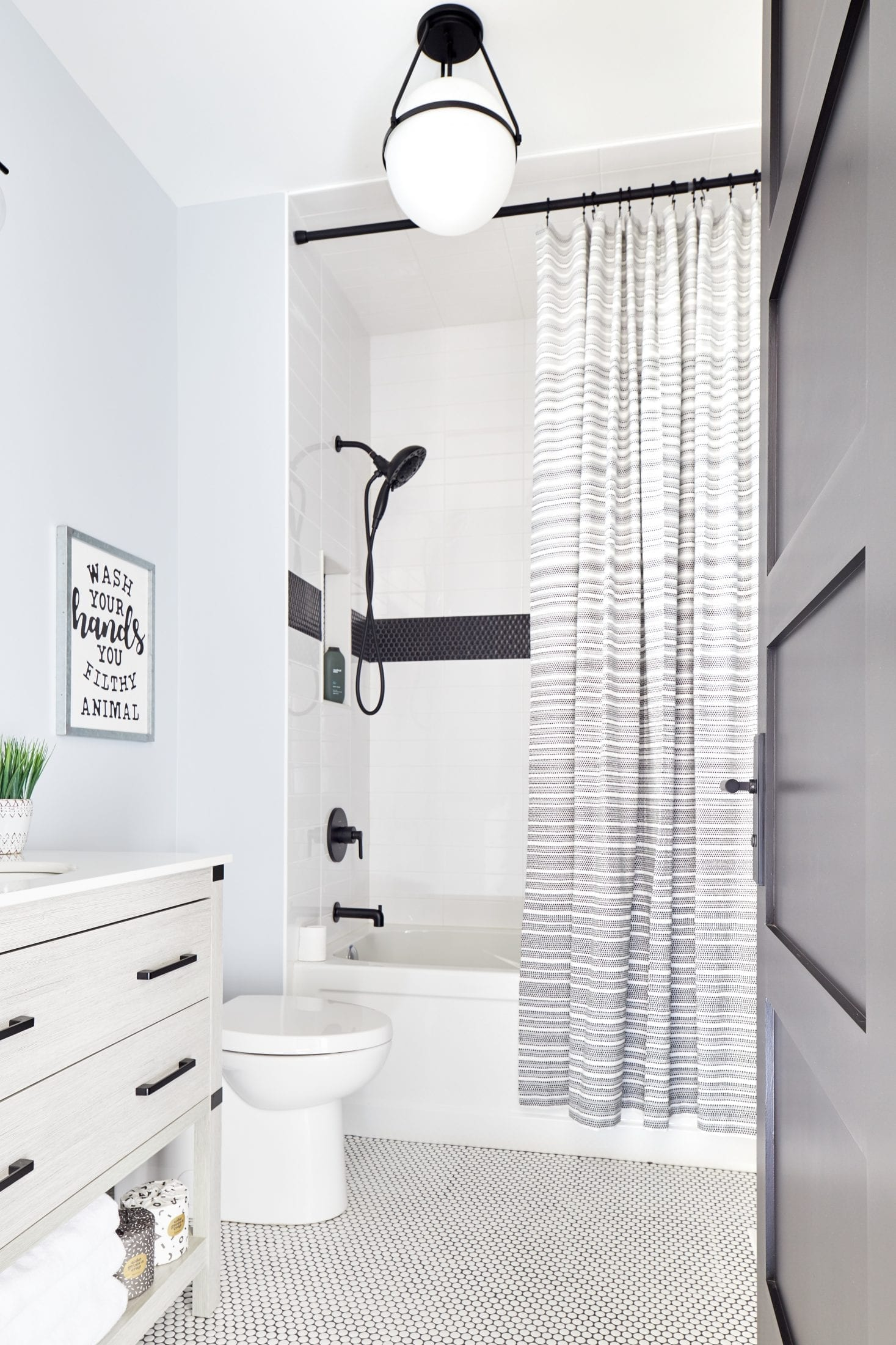 Teen boys bathroom design white and black penny tile
