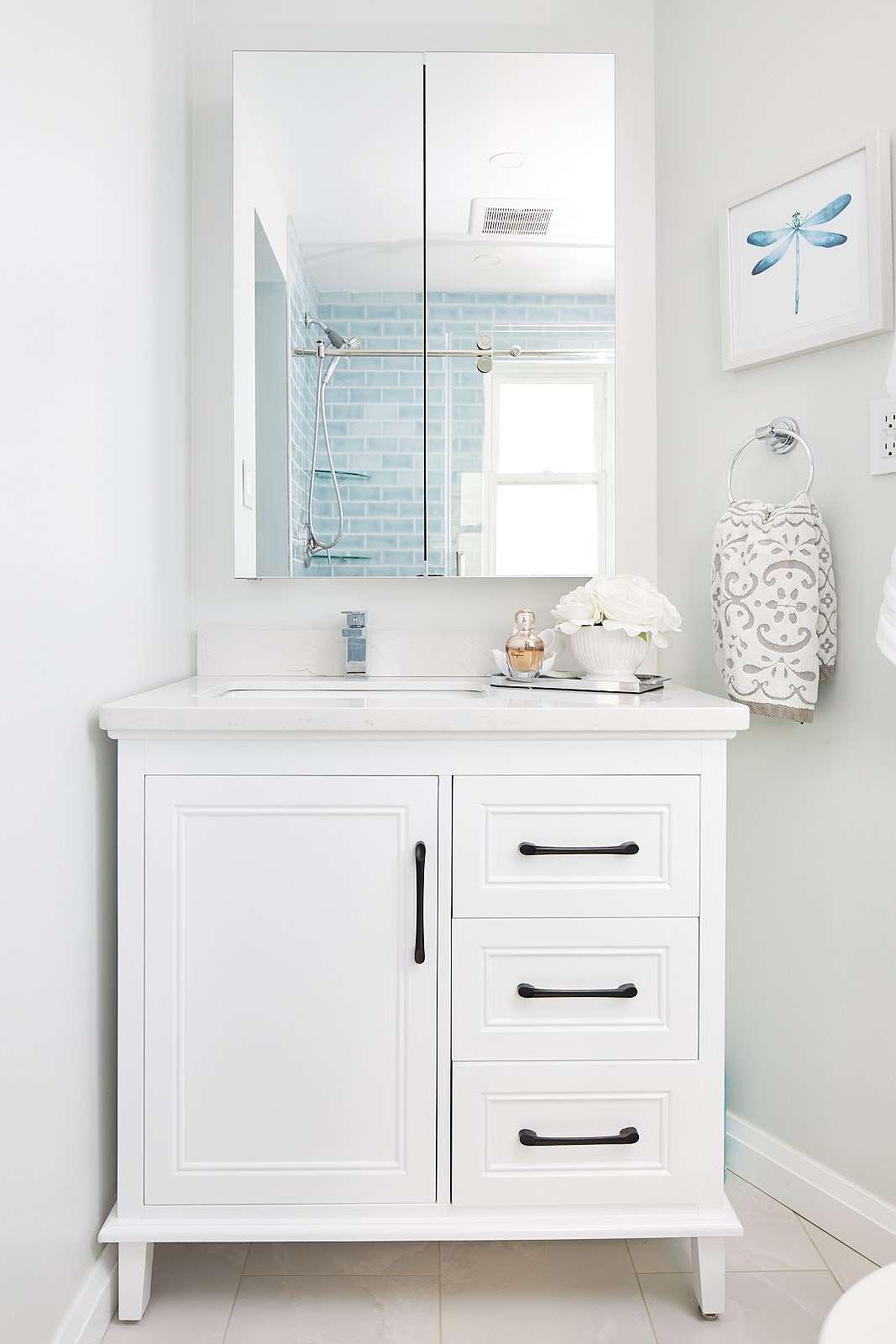 white vanity black handles mirror medicine chest