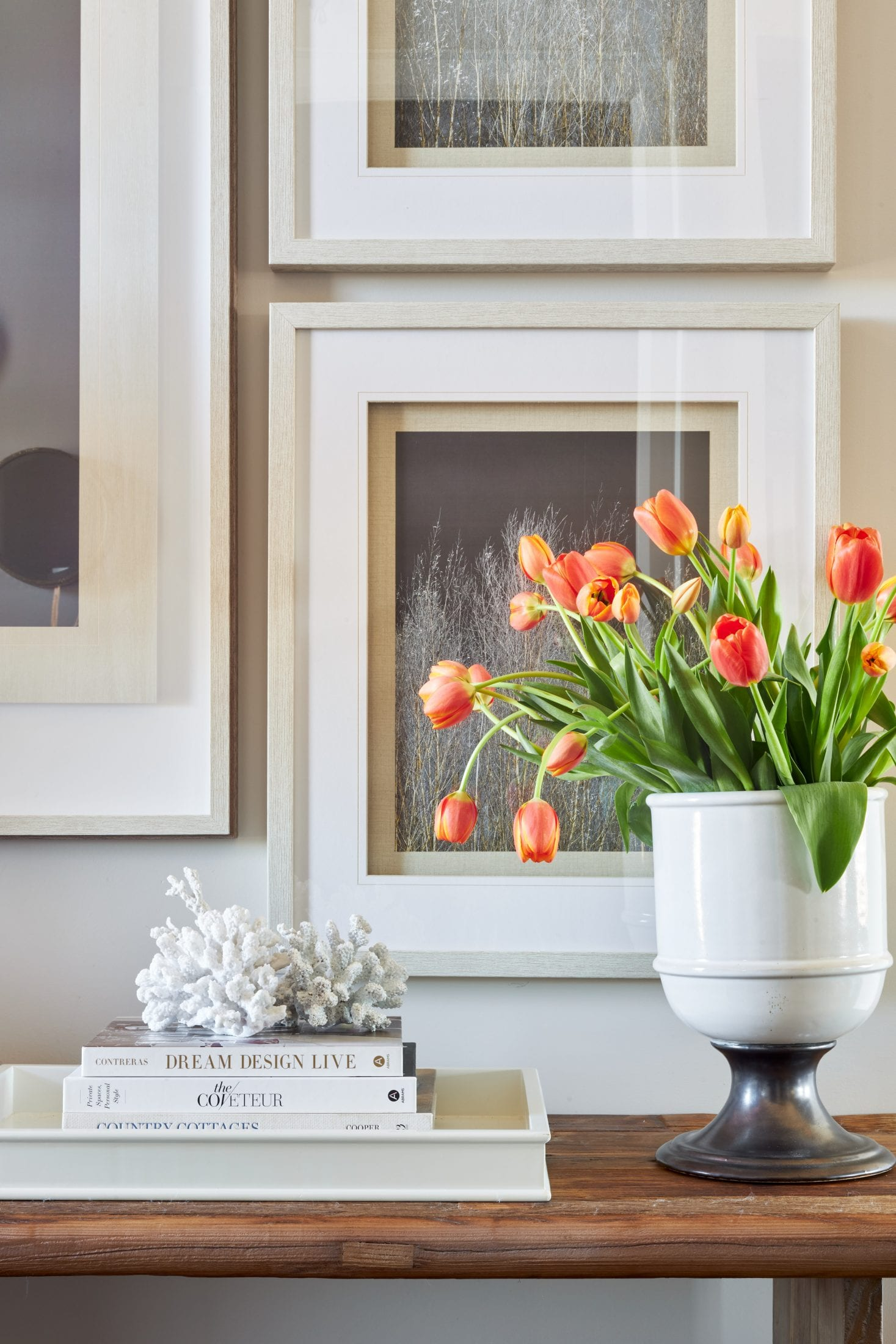 elegant gallery wall design tulips in white vase wood console table