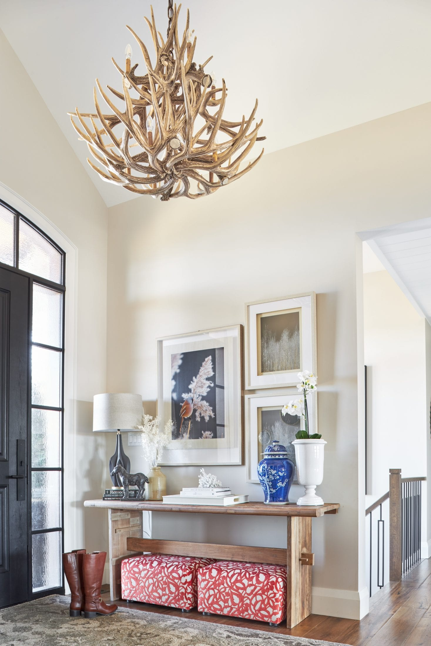 Peaked ceiling entryway design black front door console table design