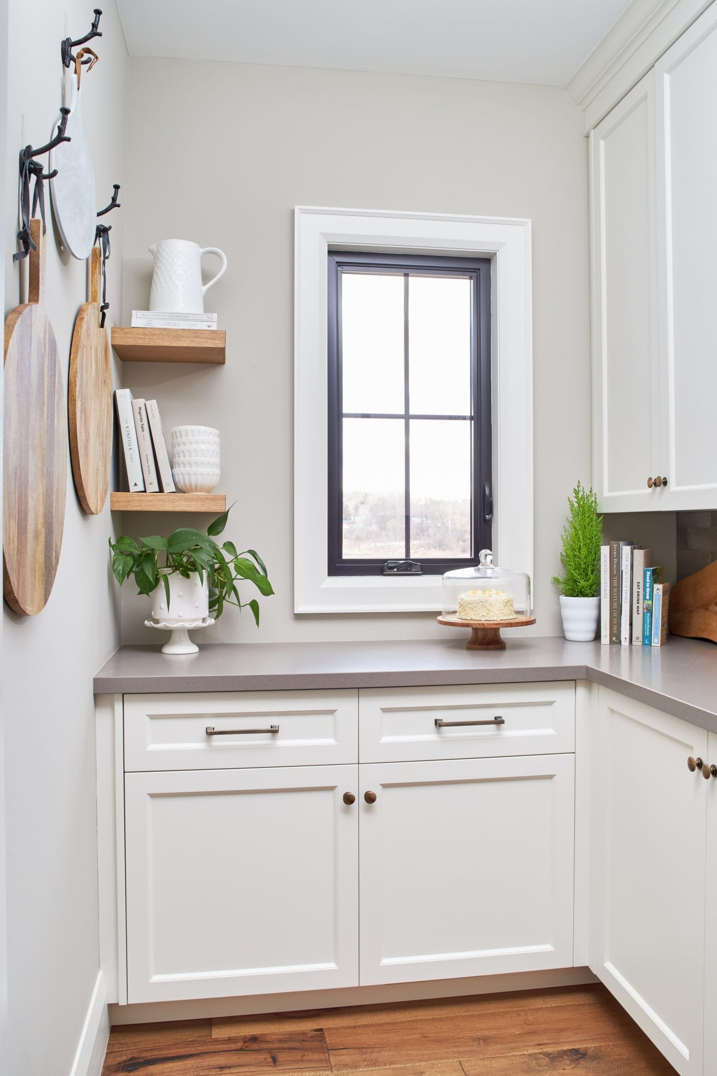 Pantry with black window and floating wood shelves