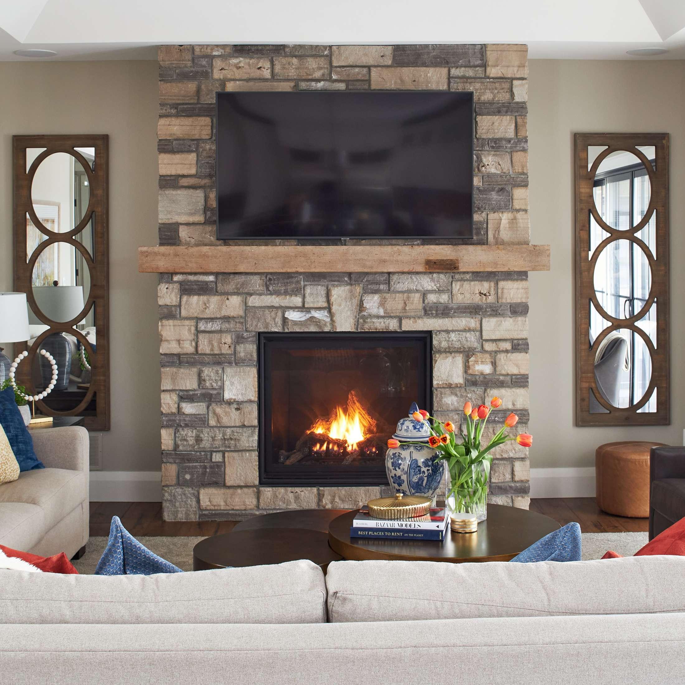 cozy family room stone fireplace design sunpan coffee table