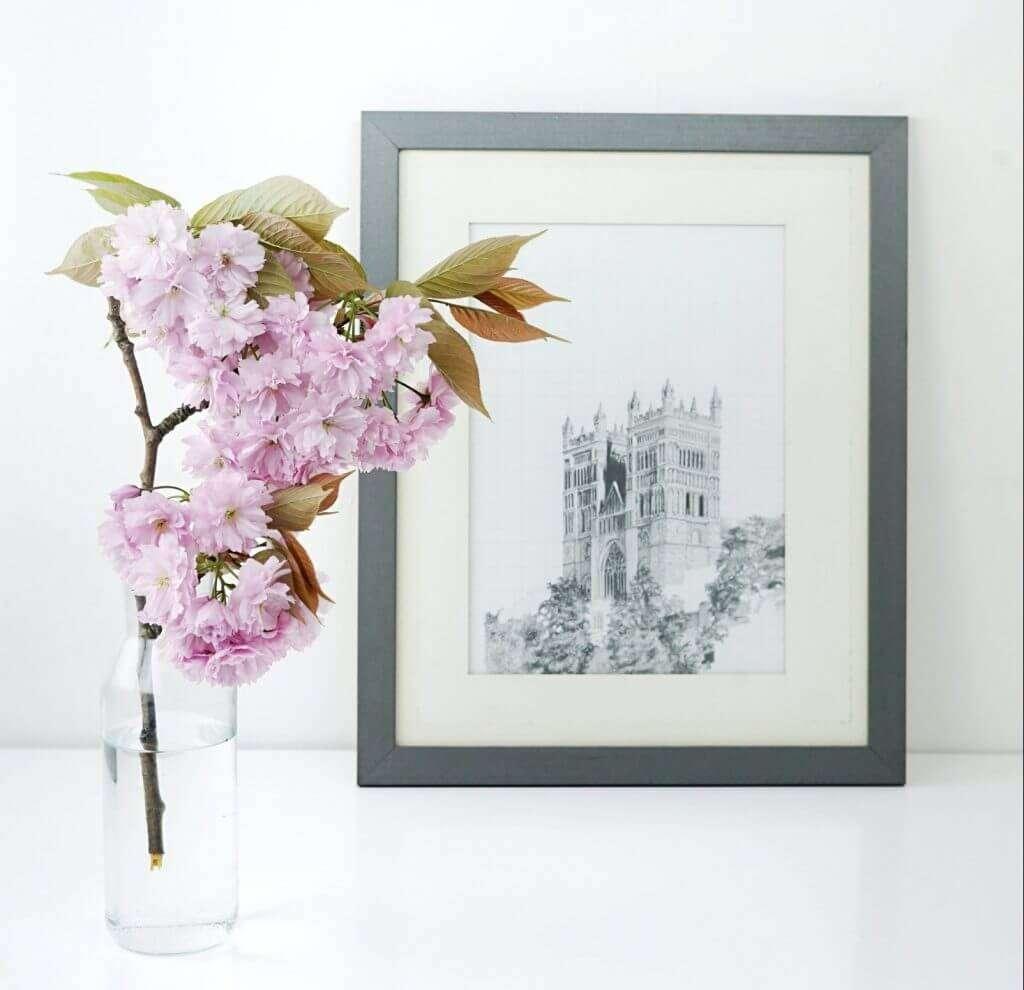 Pink Flowers in vase and black framed art